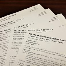 Photo of a stack of sample SMAC grant contracts.
