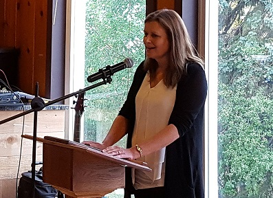 Photo of Prairie Disciple winner LeAnn Atchison speaking at a podeum with a mic when accepting the award.