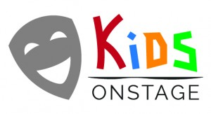 "Kids on stage logo-smiling grey theatre mask to the left, with ""Kids"" written in rainbow colors written on the right, over black letters of ""on stage"""