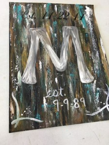 """Example of monogram painting. Abstract background with large silver """"M"""" painted in the middle."""
