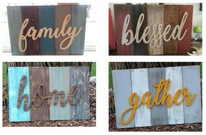 "Sign examples, ""family"" ""blessed"" ""home"" ""gather"", raised word laid over different colors/blocks of wood."