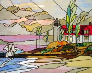 Stained glass artwork of lakeside lighthouse.