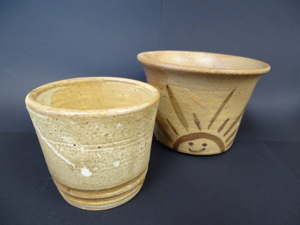 Pottery by student artist Isaac Brouwer. Two bowls, beige.