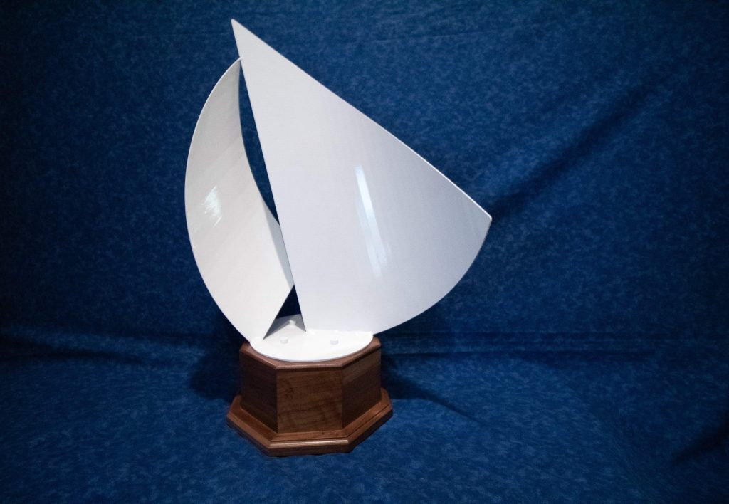 White sailboat sculpture that artists will be able to put their designs on