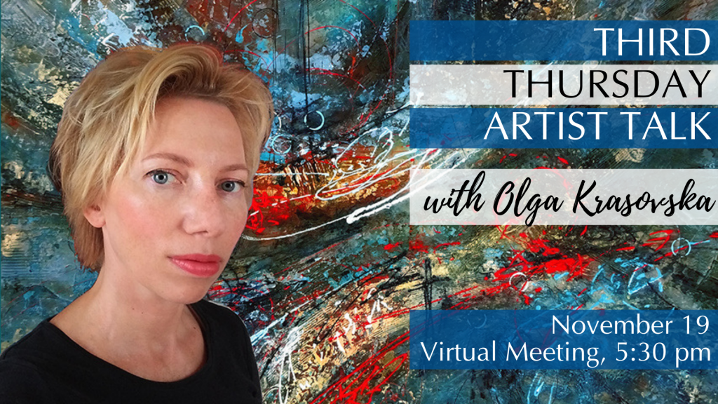Artist Olga in front of one of her colorful abstract paintings.