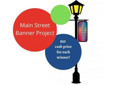 "Main Street Banner Project: $50 cash prize for each winner! Image of streetlight clipart that says ""welcome"" on a banner hanging from it and text is in various sized circles in neon green, red, and blue."