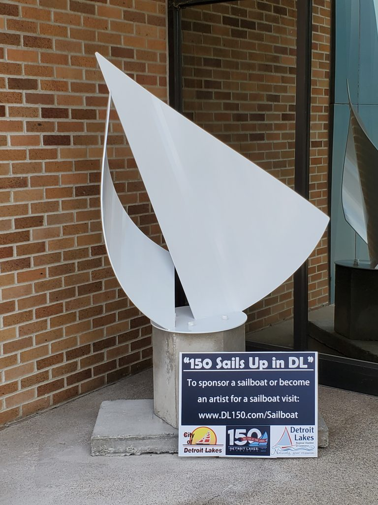 """Photo of blank/white sailboat sculpture. """"150 Sails up in DL"""" To sponsor a sailboat to become an artist for a sailboat, visit: www.DL150.com/Sailboat"""