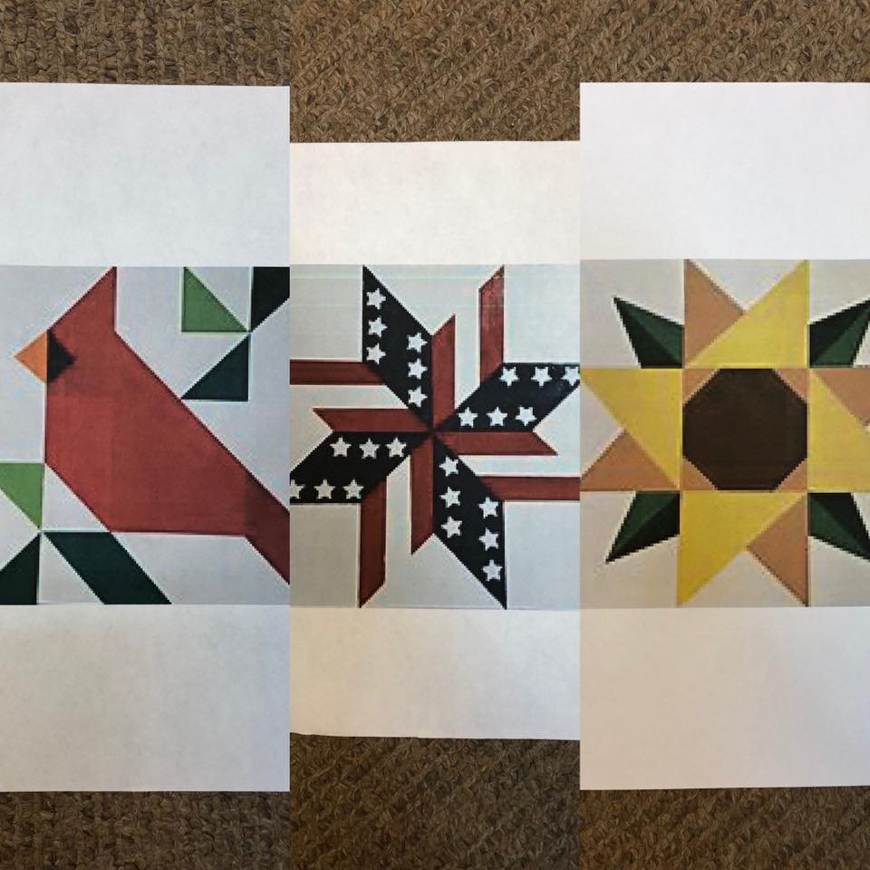 Photo of 3 barn quilt designs. Cardinal, patriotic star, and sunflower.