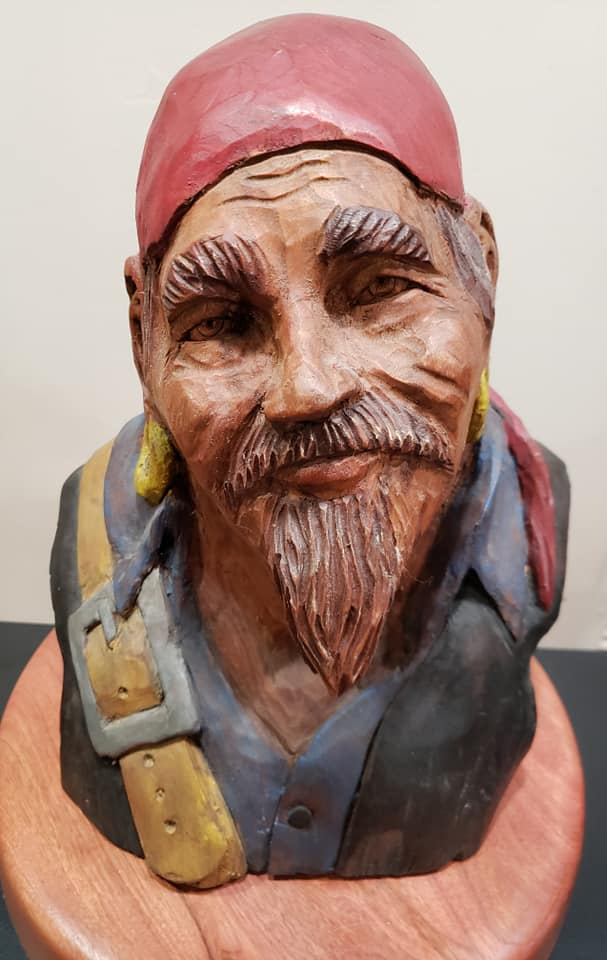 carved pirate head that's also been painted