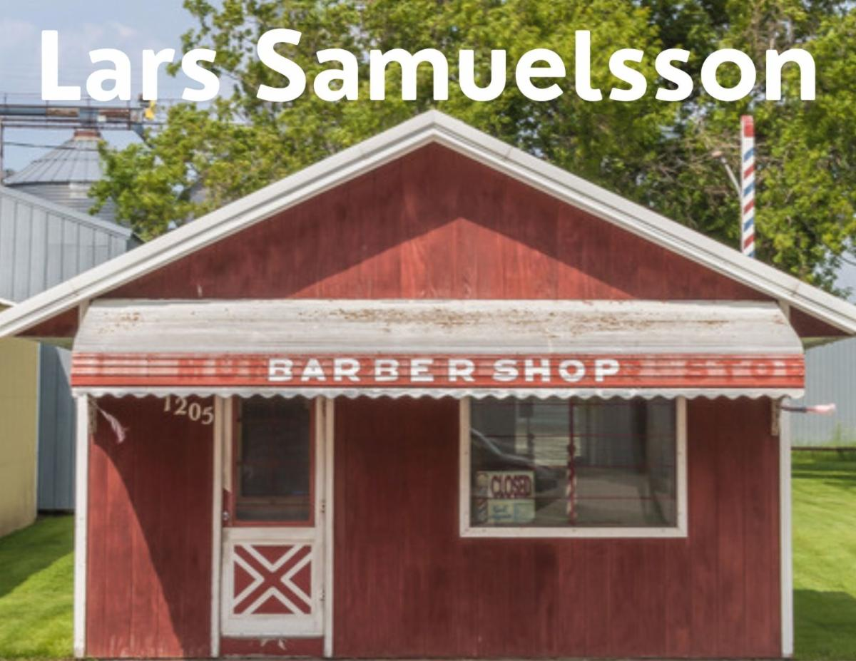 Lars Samuelsson. Photo of small red and white shed with sign that says,