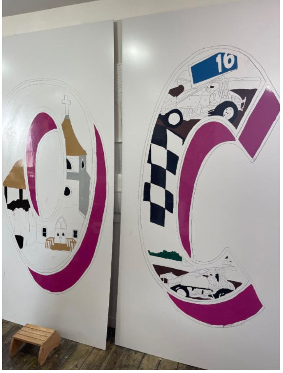 """Examples of the partially finished """"O"""" and """"C"""" from the Jackson community letter mural."""